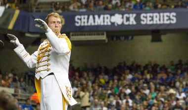 A Notre Dame drum major surveys the field in San Antonio.