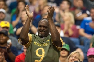 A fan cheers on the Irish in Notre Dame's win in San Antonio.