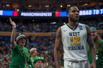 A member of the Notre Dame band yells at a West Virginia player.