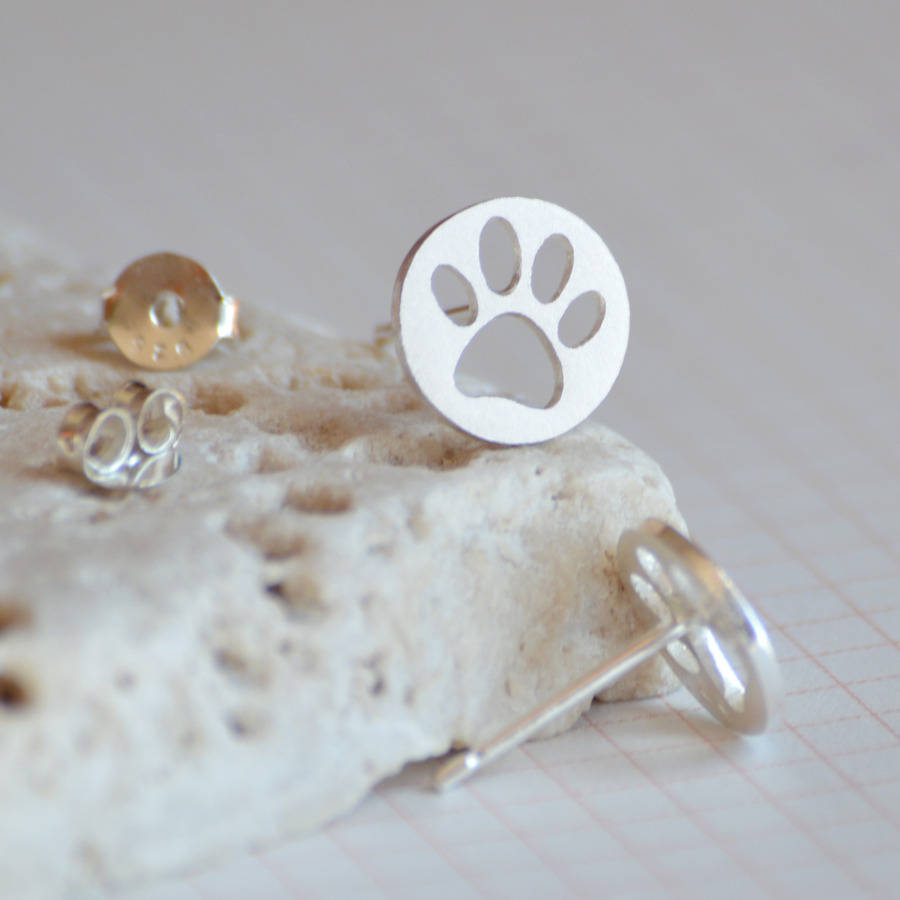 hollow pawprint earring studs in sterling silver by huiyi