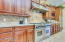 Beautifl granite and natural stone back splash and high end gas cooktop/ovens