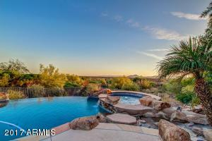 Camelback Mountain, City Light Views, Golf Course and a Vacation back yard with putting green, heated spa and Pool, extensive patio, bar-b-que center and Firepit