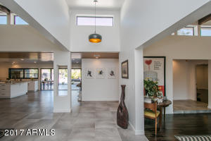 Entrance opens to large living room, dining room and kitchen with tons of natural light