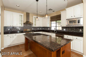 Custom backsplash, granite, island, ss appliances with gas cooktop