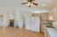 Kitchen is open to great room with vaulted ceilings for a spacious feel