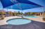 There are several community pools, but this one is heated for year round enjoyment. Plenty of sunning chairs and deck area. Shade structures can be found in the pool and over the playgrounds. The community is very well maintained.