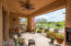 Back patio with fireplace overlooking double fairways and mountain views