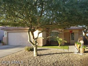 Beautiful South facing home with great curb appeal. Artificial grass with large planters.