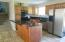 Beautiful cabinets and dark granite compliment SS appliances. Watch backyard while prepping food or doing dishes.