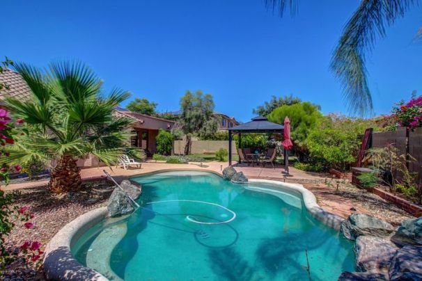 Gorgeous Pebbletec Pool for hours of fun at 15253 W Elm St in sunny Goodyear AZ.
