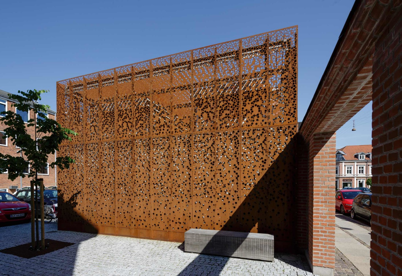 Rocking Chair Kogan Perforated Corten Panels As Cladding Municipal Building