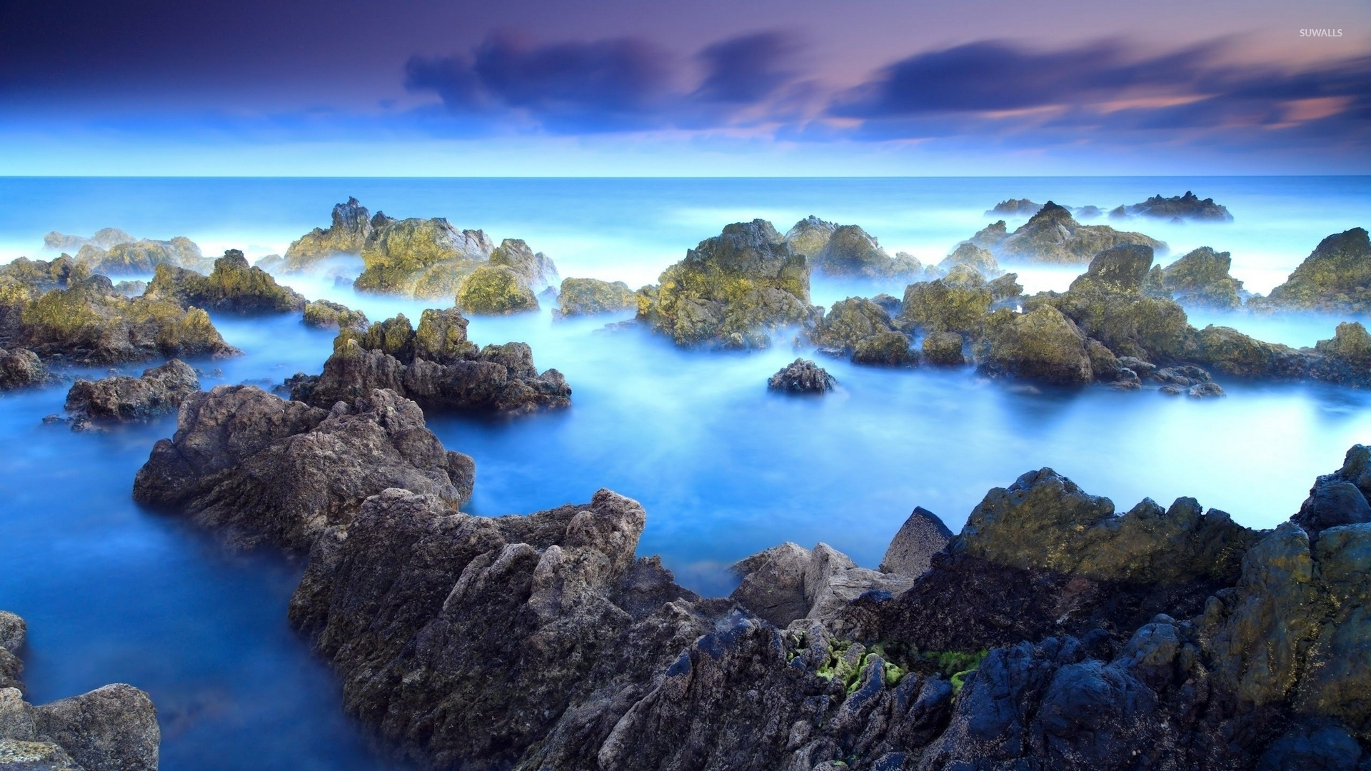 3d Beach Wallpaper For Walls Mossy Rocks Rising From The Amazing Blue Ocean Wallpaper