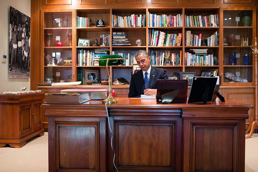 """President Barack Obama signs a copy of former South African President Nelson Mandela's book """"Conversations with Myself"""" while visiting Mandela's office at the Nelson Mandela Centre of Memory in Johannesburg, South Africa, June 29, 2013 © The White House/WikiCommons"""