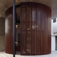 Curved and Stacking Louvered Glass Doors Surround Room in ...