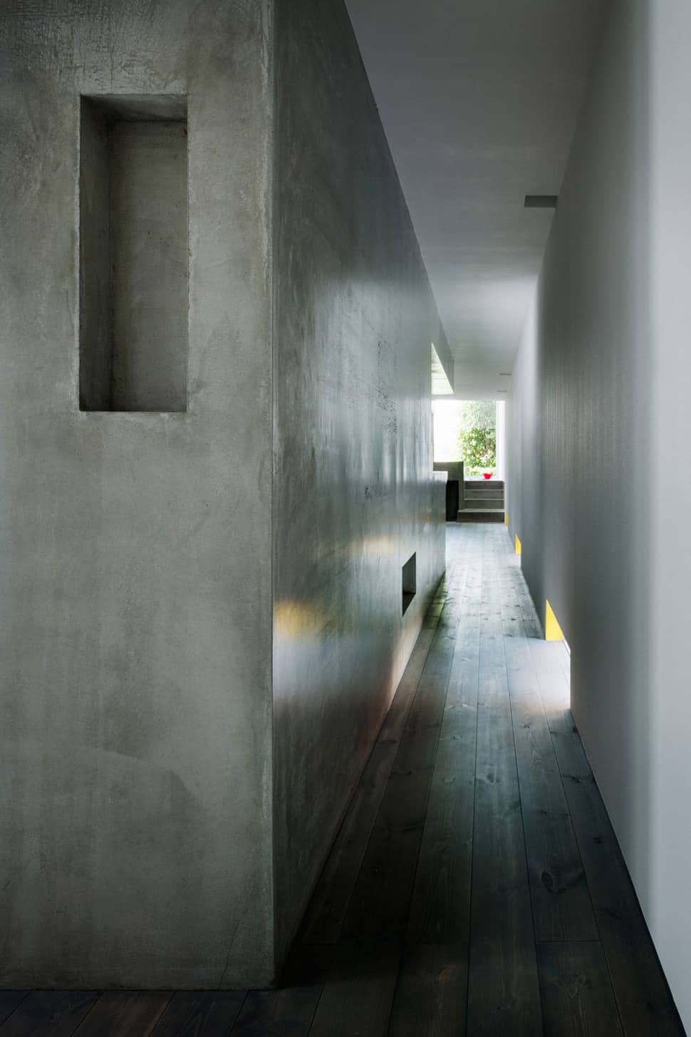 Concrete Rooms Narrow Urban Home With Concrete Walls And Upper Bridge