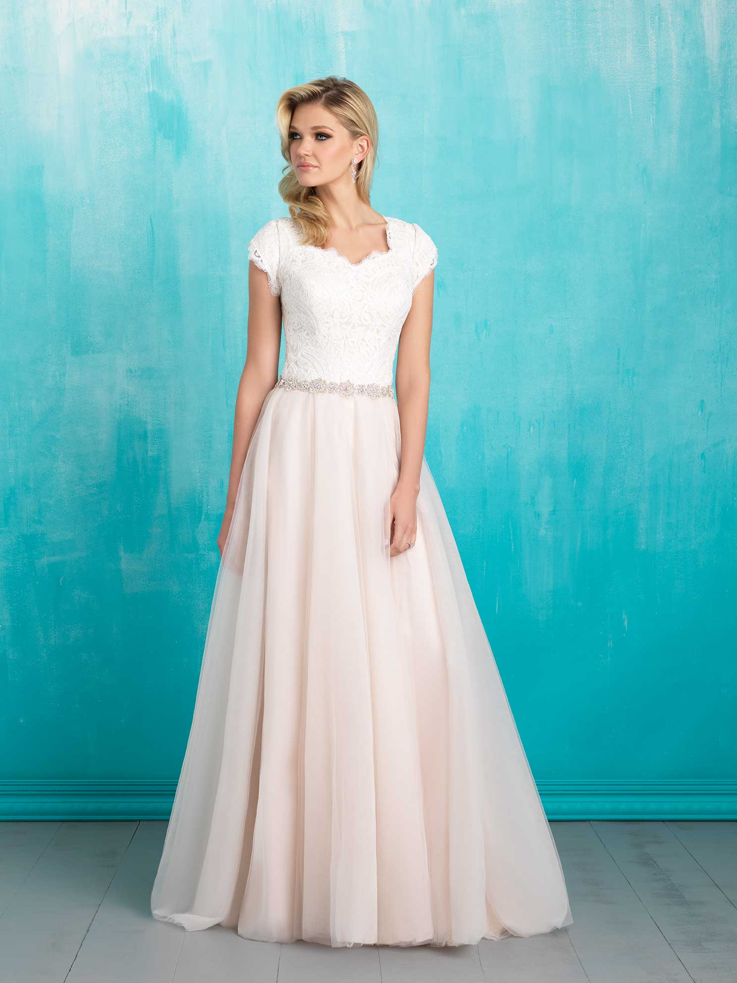 modest wedding dress shopping modest wedding dresses cheap A bride in a white and pink wedding dress standing against a blue background