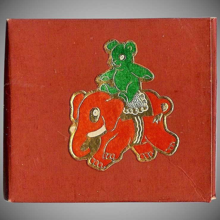Christmas decoration gummed seals depicting a Teddy bear riding a