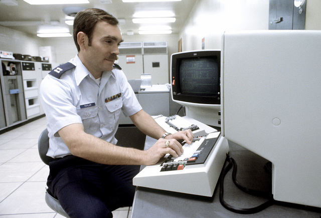 CPT Roderick Taylor, computer systems analyst, works with an IBM
