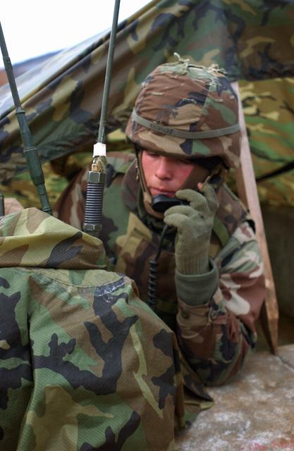 US Marine Corps (USMC) Lance Corporal (LCPL) Michael Schutt, a Radio