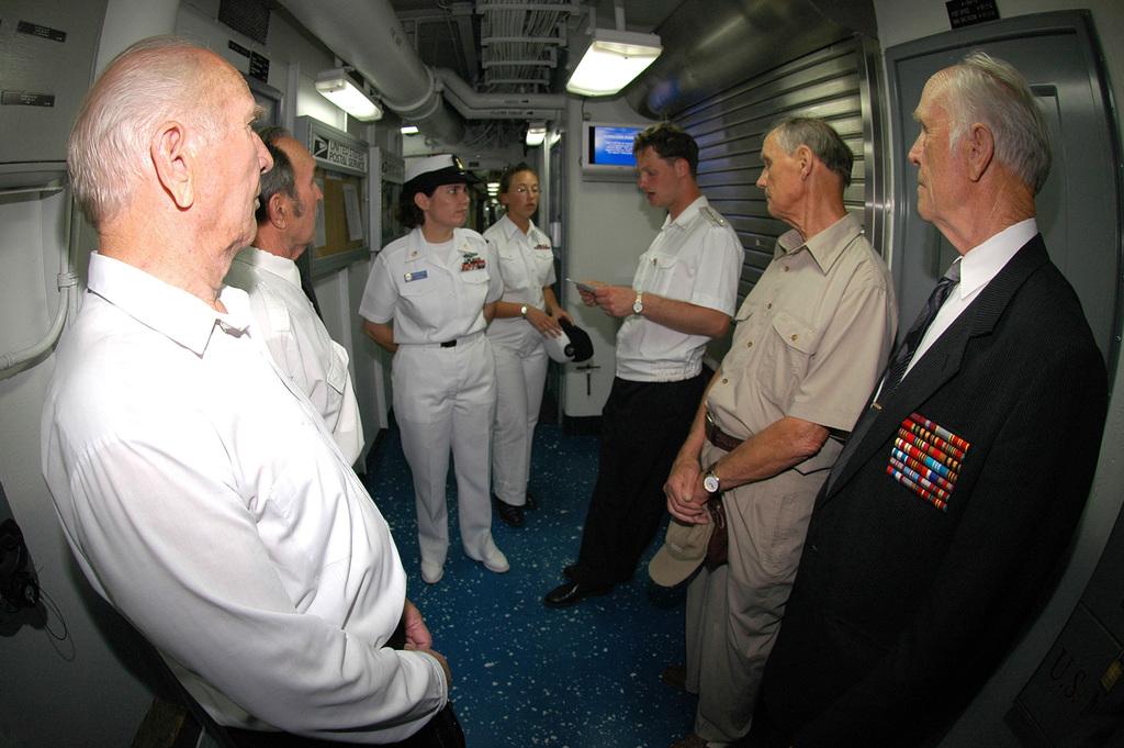 US Navy (USN) CHIEF MASTER-At-Arms (MAC) Mary McQuain explains the - us navy master at arms