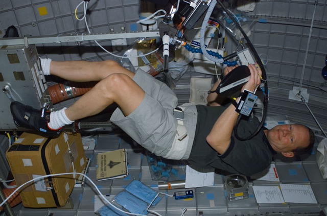 S107E05054 - STS-107 - Brown exercises on the Ergometer as part of