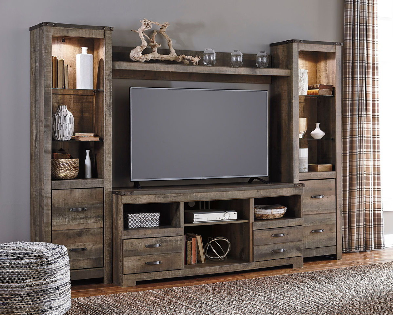 Trinell Entertainment Center Large Tv Stand 2 Tall Piers Bridge On Sale At Stringer Furniture Serving Jackson Ms