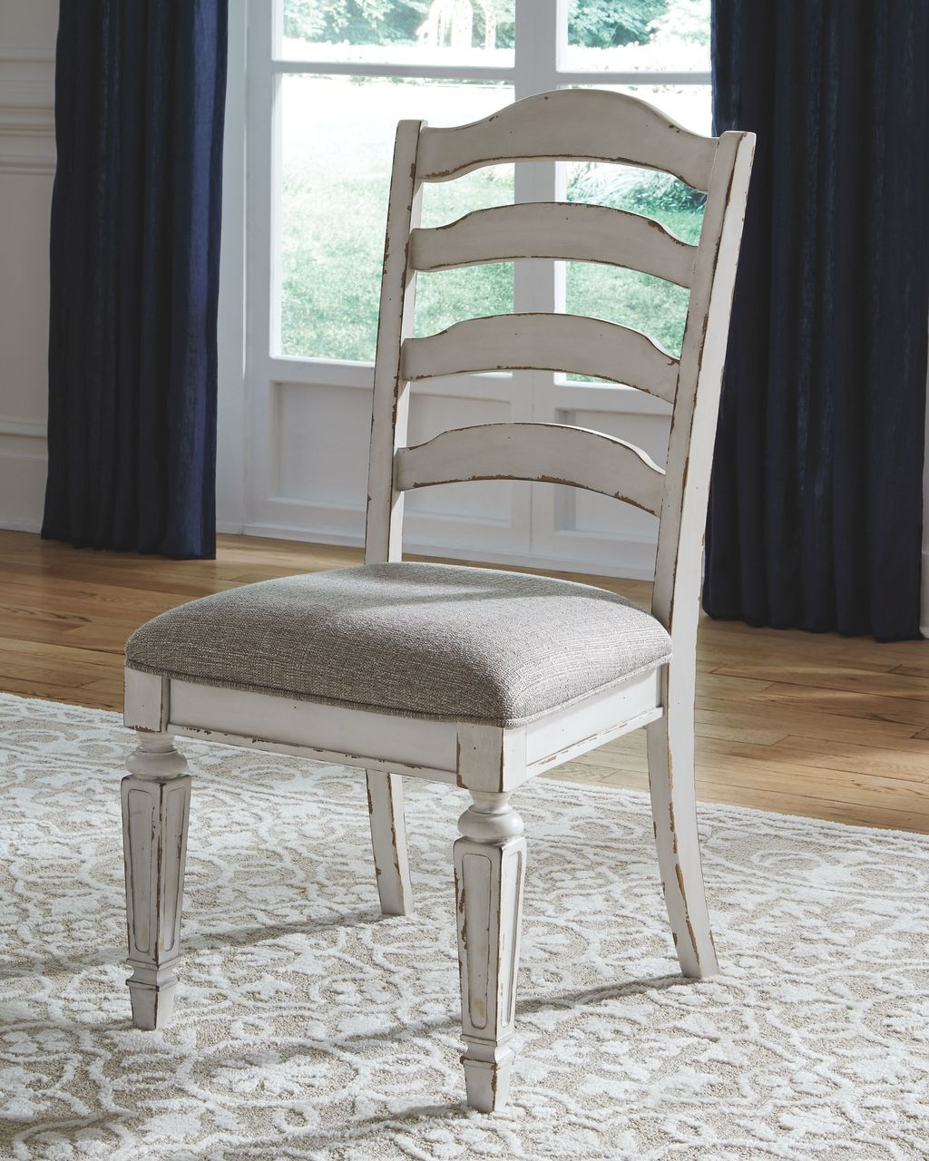 The Realyn Chipped White Dining Upholstered Side Chair 2 Cn Available At Ritz Furniture Planet Serving Mississauga On