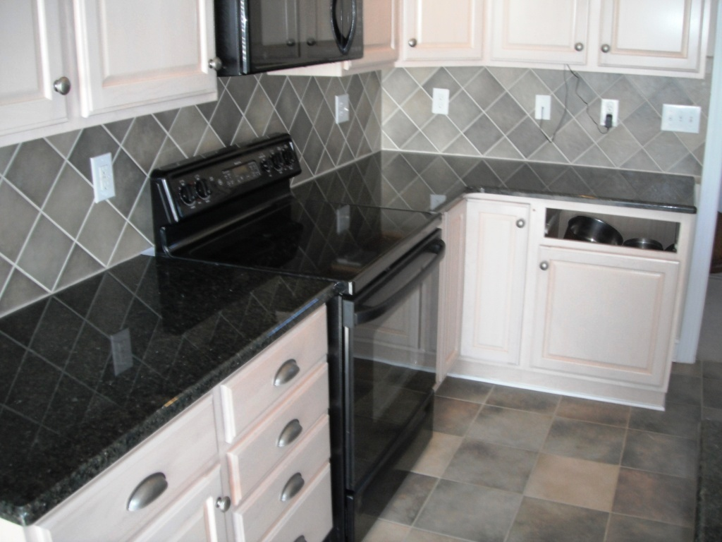Different Countertop Surfaces Uba Tuba On White Cabinets