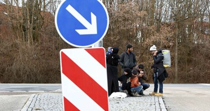 Migrants make a break in Erding downtown after their visit to the first registration camp of Erding near Munich, Germany, January 27, 2016
