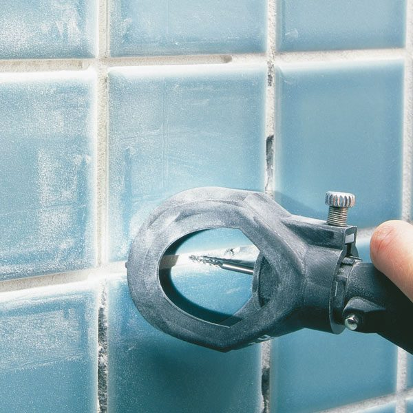 How To Regrout Bathroom Tile: Fixing Bathroom Walls | The Family