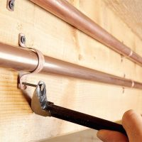 Quiet Pipes With Pipe Straps | The Family Handyman