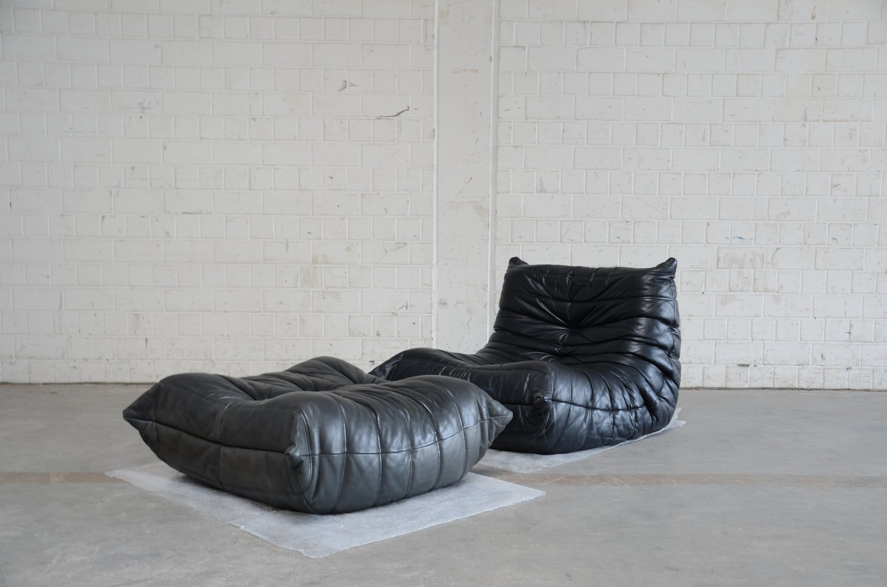 Togo Sofa Pamono Vintage Togo Chair And Ottoman In Black Leather By Michel Ducaroy For Ligne Roset