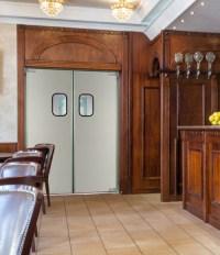 Sleek Stainless Steel Swinging Doors for Commercial Kitchens