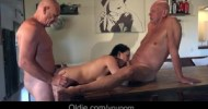 Young babe flirting and fucking two old guys on the kitchen table