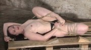 Sexy fetish model Caroline Pierce lesbian bondage and tied damsel in distress roped to a floor in the kinky dungeon