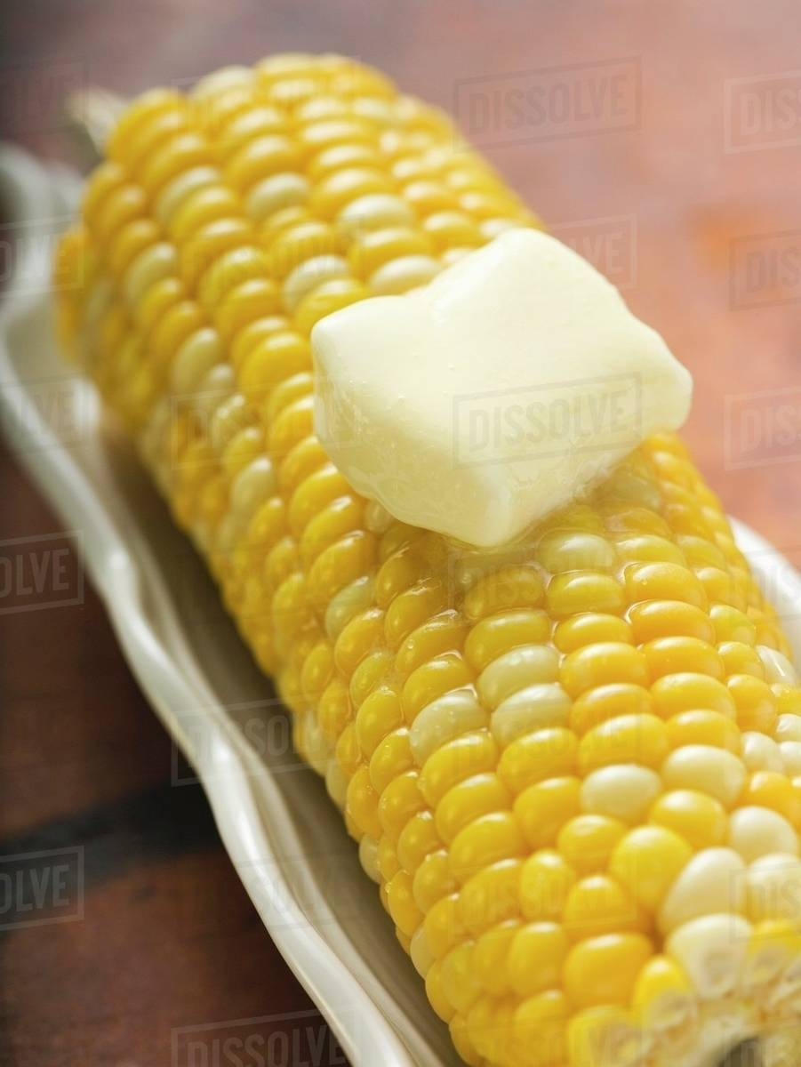 Cuisines Knob Corn Cob With Knob Of Melting Butter Stock Photo