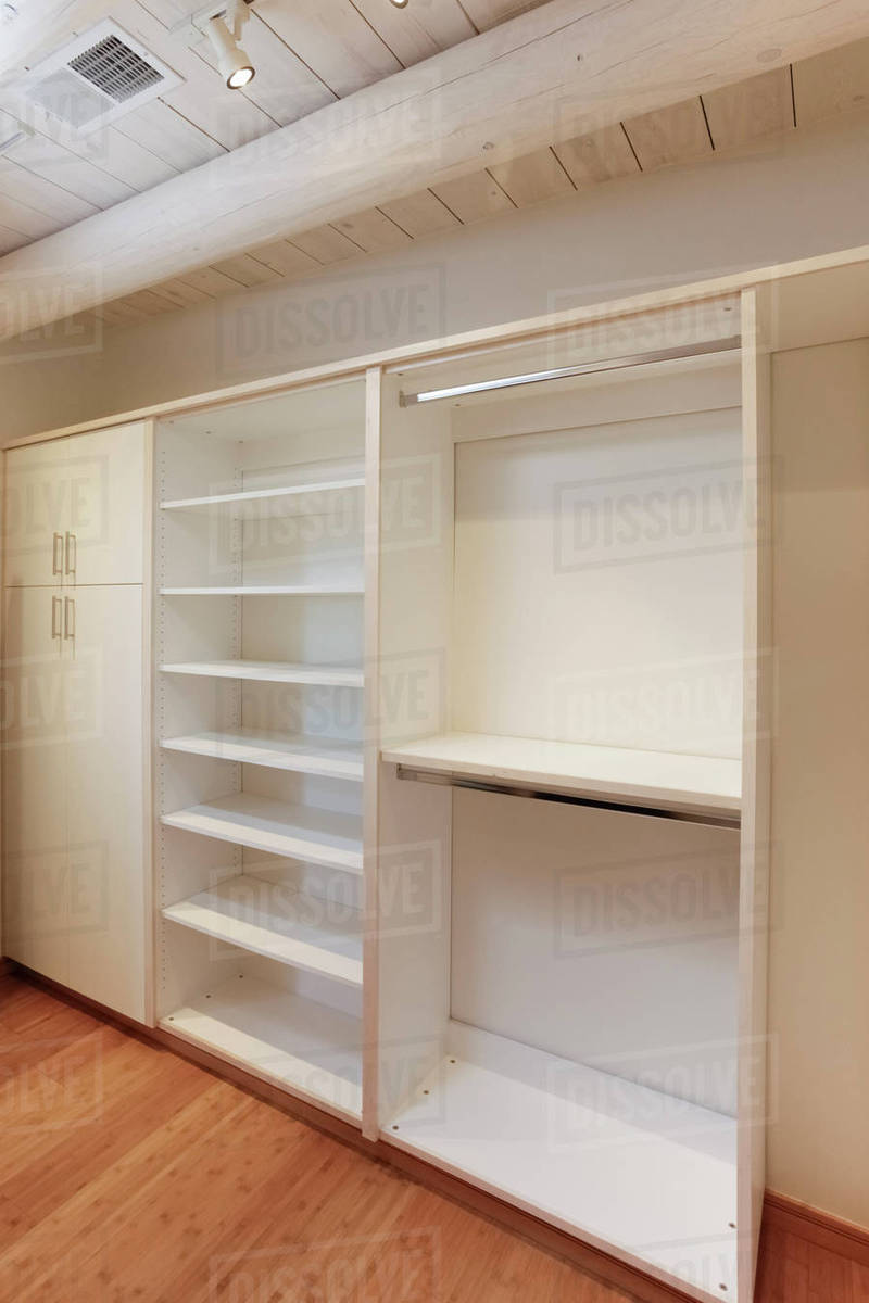 Walkin Closet Cabinets Cabinets And Empty Shelves In Walk In Closet Stock Photo