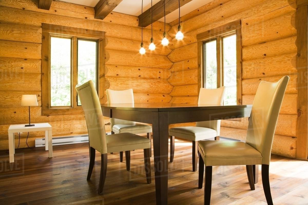 Dining Room Modern Lighting Dining Table And Chairs With Modern Lighting In Eastern White Pine Log Cabin Stock Photo