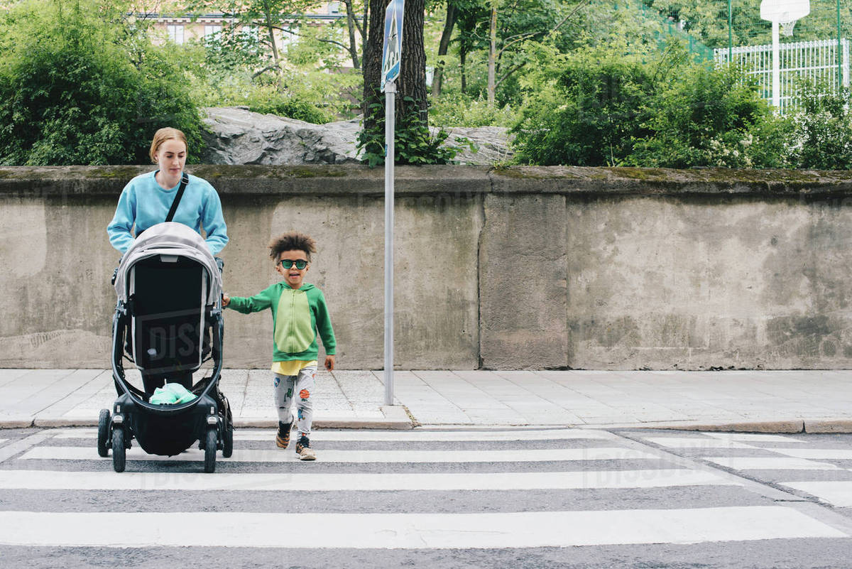 Baby Pushing Pram Youtube Mother Pushing Baby Stroller While Crossing Road With Son At City Stock Photo