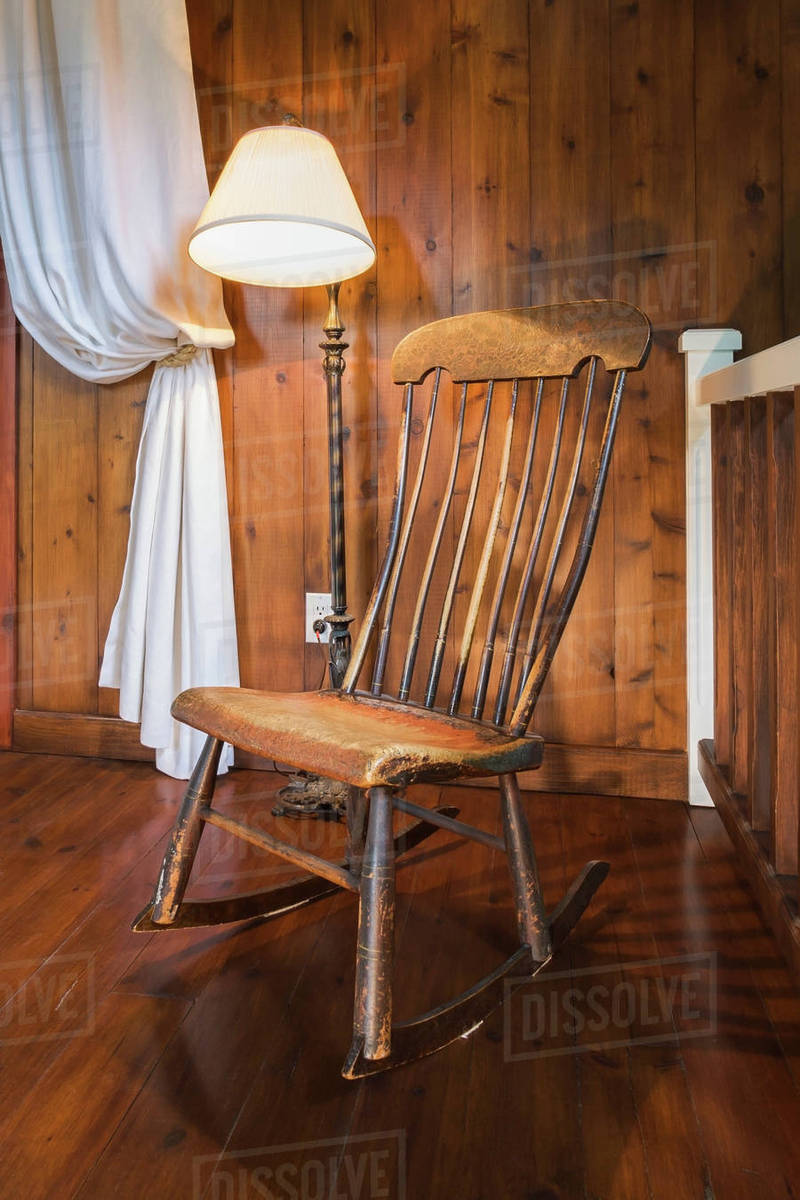Wood Rocking Chair Antique Wooden Rocking Chair And Lamp Inside A New Hampton Style Home Quebec Canada Stock Photo