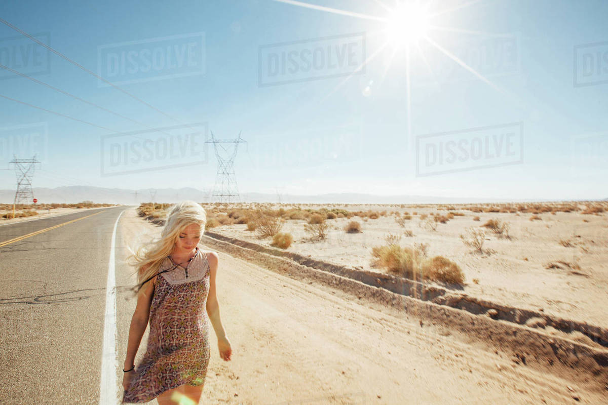 Free Photography Stock Woman Walking On Road By Desert During Sunny Day Stock Photo