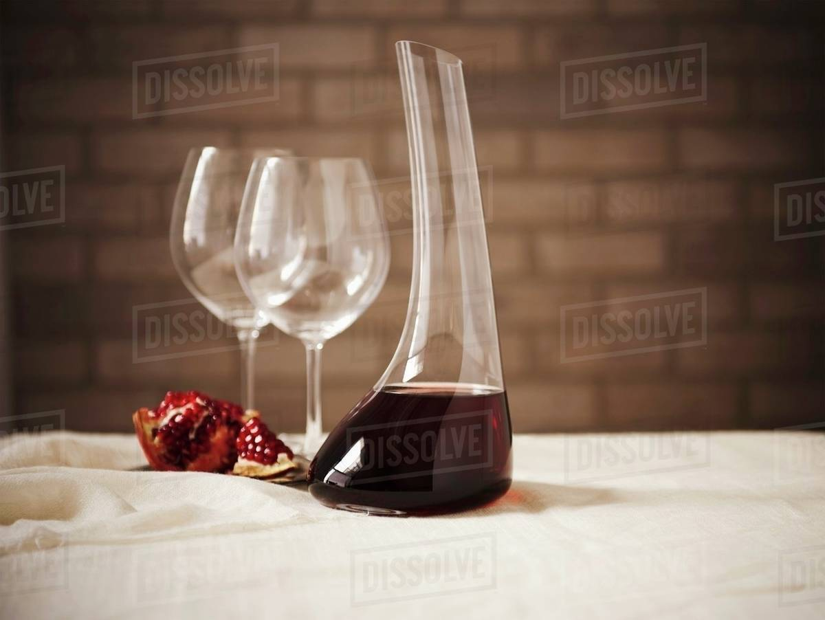Decanter Wine Glas Red Wine In A Wine Decanter With Two Empty Glass And Pomegranate Stock Photo
