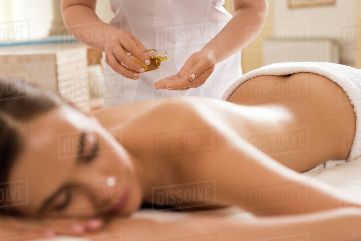 Salon Massage Body Body Massage Therapist Making Massage With Body Oil For Woman In Spa Salon Stock Photo