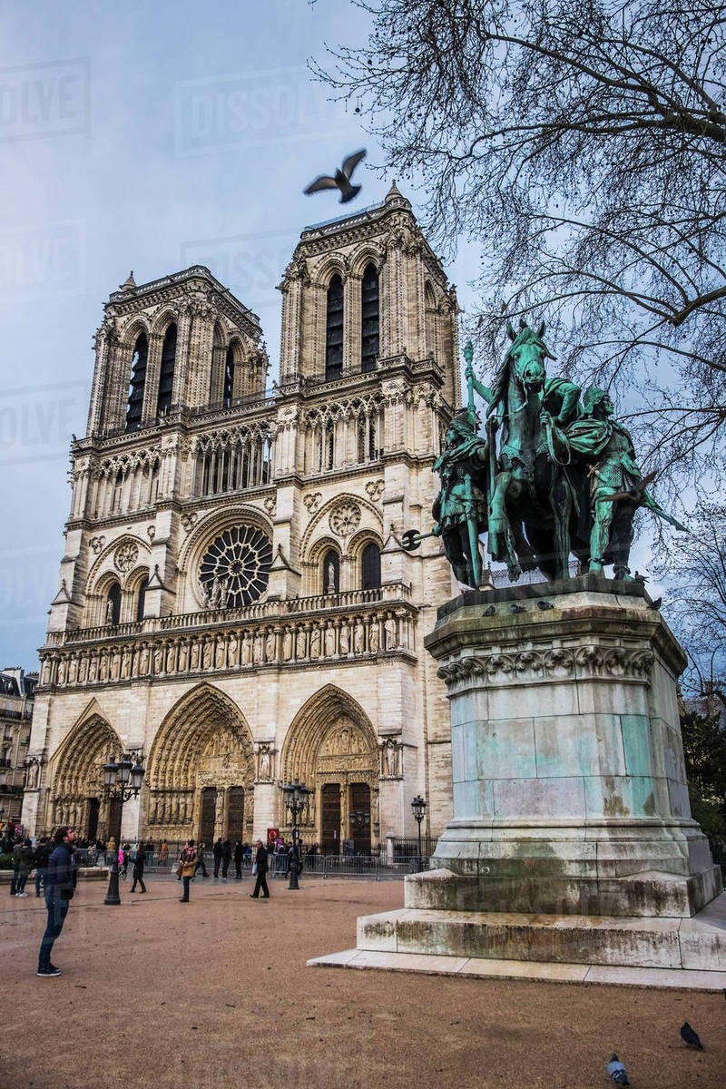 Photo Stock Paris Statue Of Charlemagne In Front Of The Notre Dame Cathedral Paris France Stock Photo