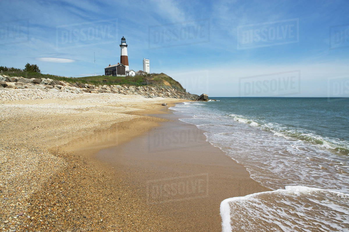 Lighthouse Background Beach With Lighthouse In Background Stock Photo
