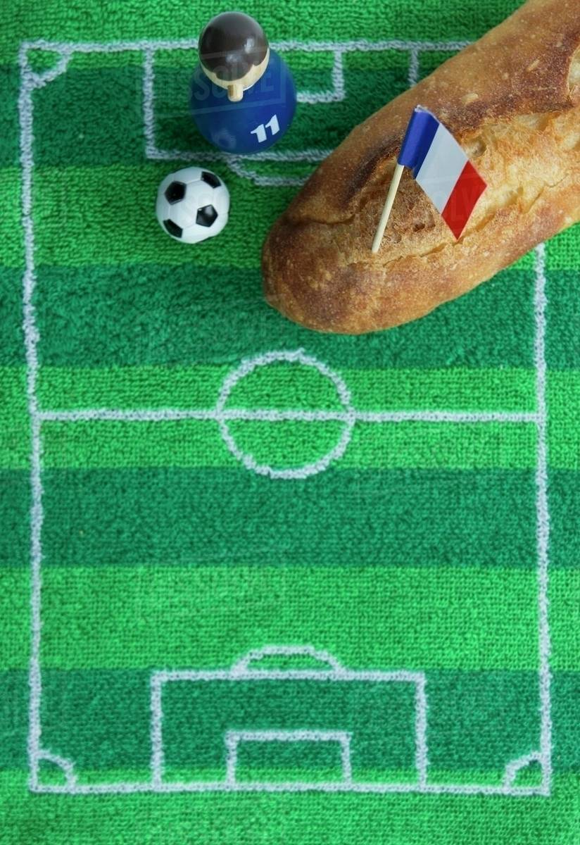 Baguette De Décoration A Baguette With A French Flag And Football Themed Decoration Stock Photo