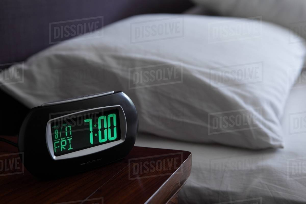 Digital Bedside Clocks Alarm Clock By Bed Stock Photo Dissolve