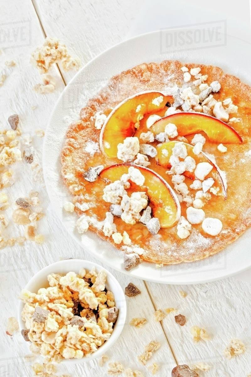 Müsli Crunchy Pancakes With Peaches And Crunchy Muesli Stock Photo