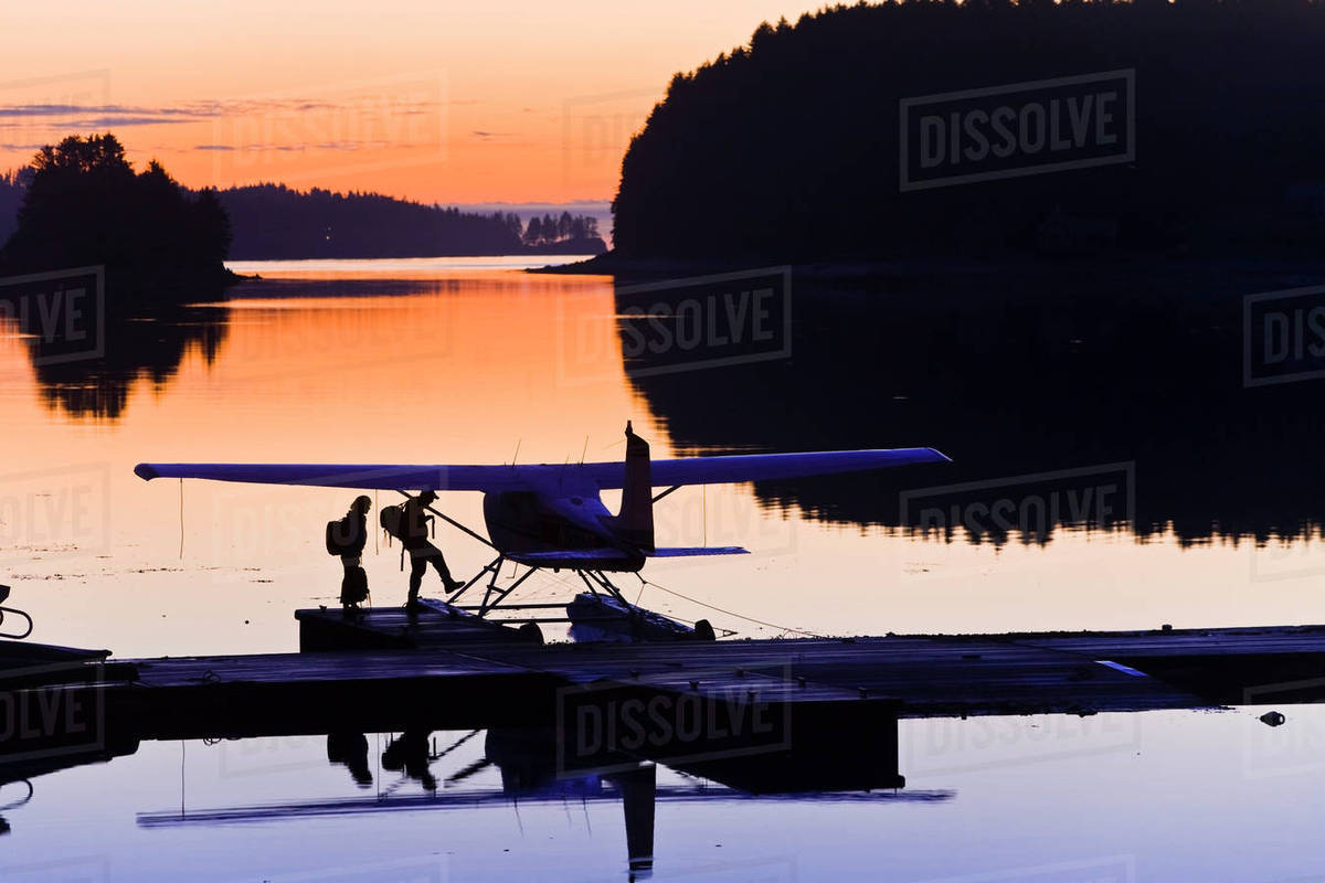 Cessna Plane Couple Boarding Small Cessna Plane On Floats At Sunrise At The Trident Basin Seaplane Base On Near Island Kodiak Alaska Stock Photo