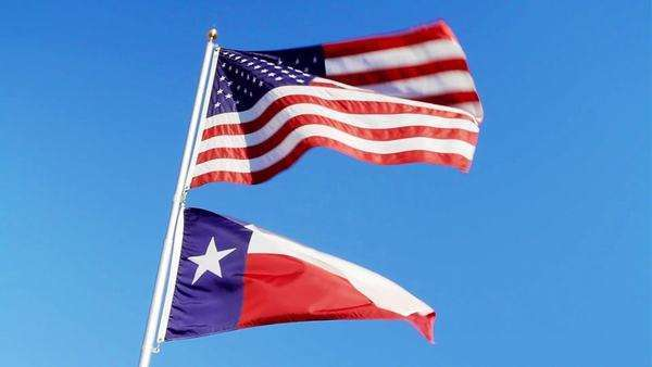 American Flag  Texas Flag waving in the wind - Stock Video Footage